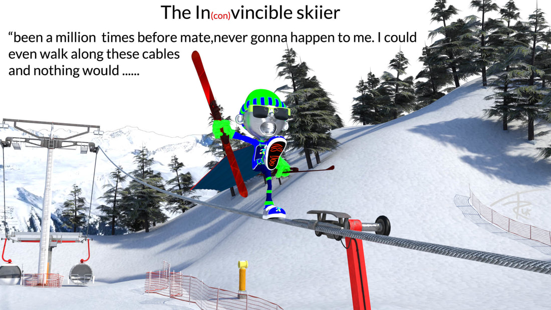 A picutre of a skiier walking along cable car cables