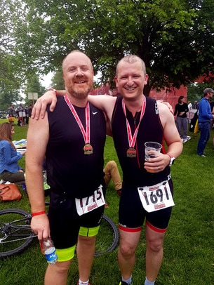 A Picture of Chris Heywood adn his mate after both completing the 2016 Bloodwise Blenheim Triathlon.